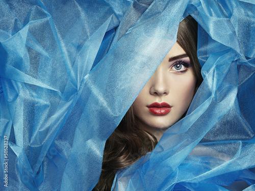 Fotografía Fashion photo of beautiful women under blue veil