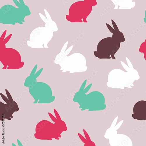 Wielkanocny bezszwowy wzór z ślicznymi królikami