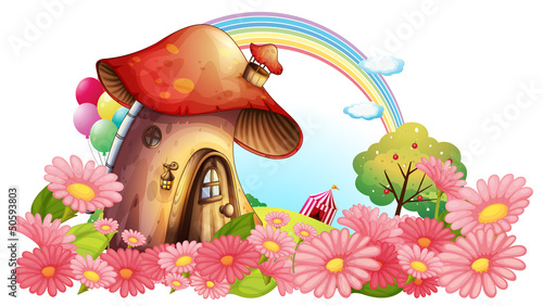 Tuinposter Magische wereld A mushroom house with a garden of flowers