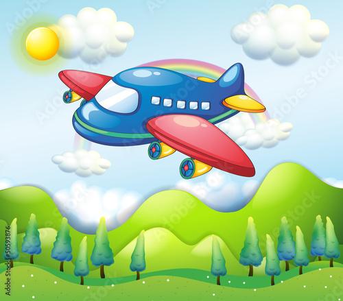 In de dag Vliegtuigen, ballon A colorful airplane above the hills