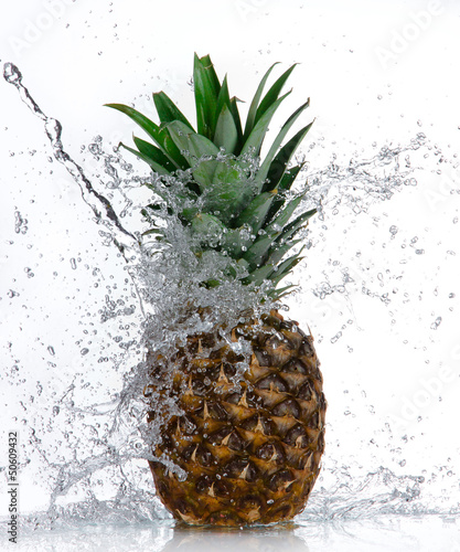 Staande foto Opspattend water Pineapple with water splash isolated on white