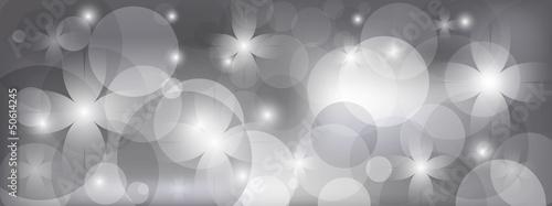 Gray floral background with bright light