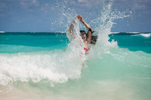 A Woman And A Wave Splash In The Caribbean Sea
