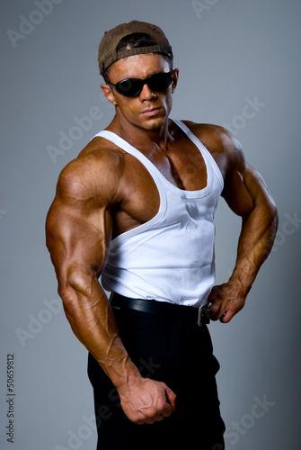 Fotografie, Obraz  Handsome athletic man in a white T-shirt