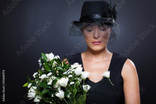 Photo  widow with flowers