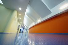 Empty Corridor With Orange Wall