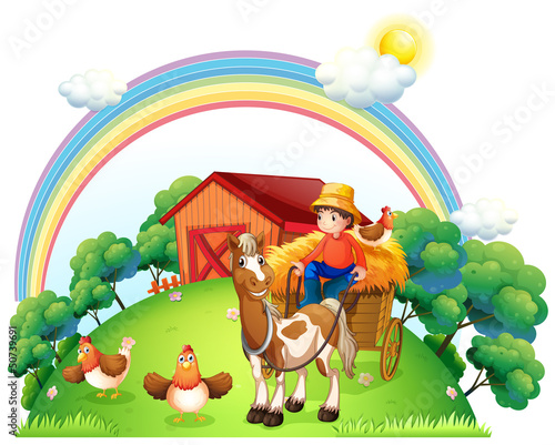 Photo sur Aluminium Ferme A boy riding in his farm cart