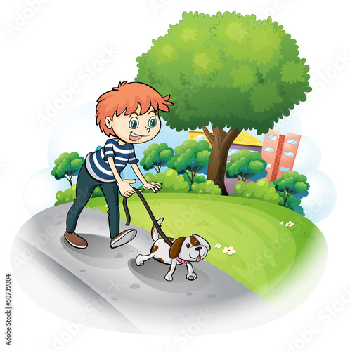 Tuinposter Honden A boy walking with his dog along the street