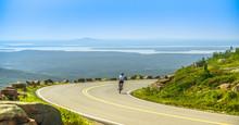 Female Mountain Bike Cyclist Riding Downhill Along Cadillac Moun