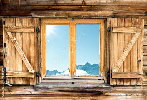 Fotografie, Obraz  weathered mountain hut window shutter