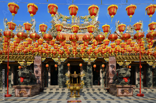 illuminated chinese lanterns hanging in chiness temple for new y