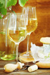 Still life with glasses of white wine and chesse