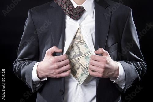 Fototapeta Concept businessman pulling back his shirt exposing money obraz