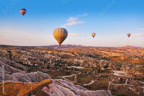Fototapety, obrazy: Hot air balloon flying over Cappadocia Turkey