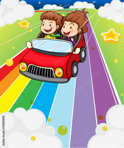 In de dag Regenboog Two kids riding in a red car