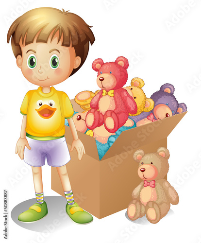 A boy beside a box of toys