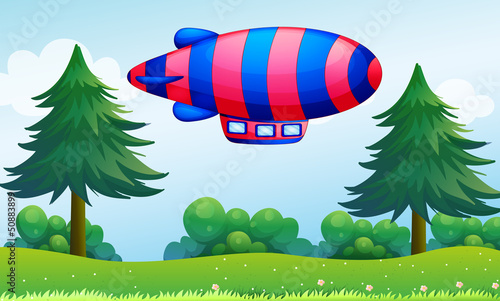 Tuinposter Vliegtuigen, ballon A colorful aircraft above the hills