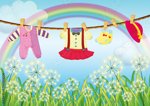 In de dag Regenboog Kids clothes hanging near the grass