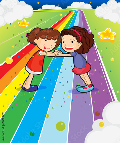 In de dag Regenboog Two girls holding their hands at the colorful road
