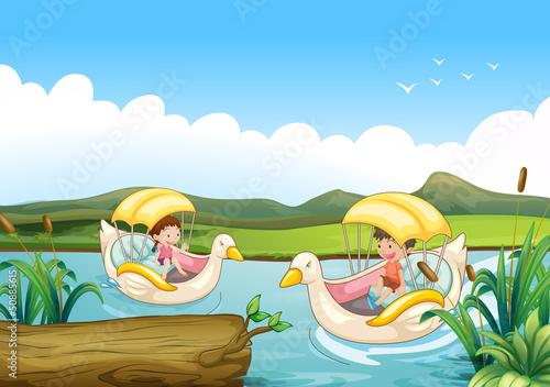 Canvas Prints River, lake Two swan boats at the river