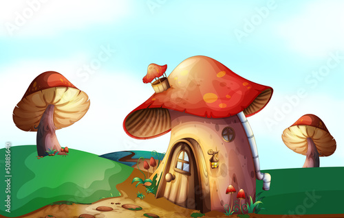 Deurstickers Magische wereld A mushroom house at the top of the hill