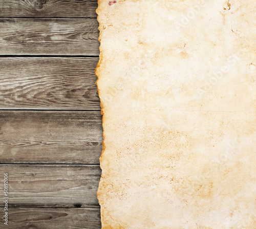 Old paper on the wood background - 50892006
