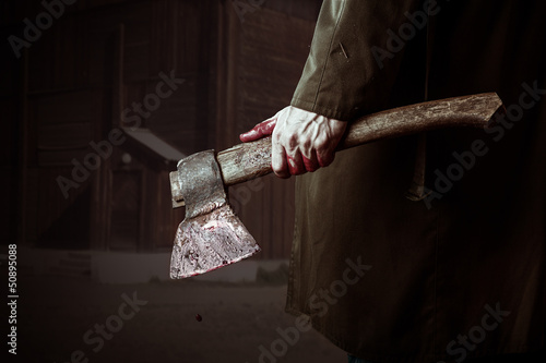 Axe with blood in male hand Canvas Print