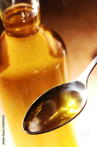 Obraz na plátne Olive Oil on a spoon