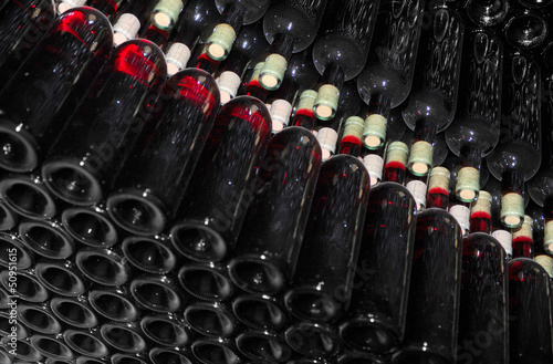 Acrylic Prints Red, black, white Old bottles of red wine