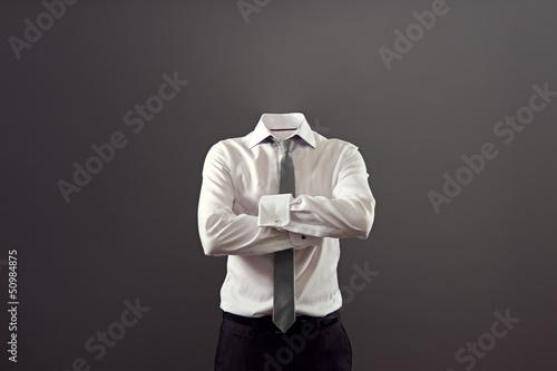 Cuadros en Lienzo Hombre invisible de pie con los brazos cruzados