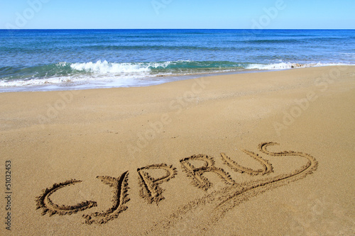 Photo Stands Cyprus Cyprus written on sandy beach