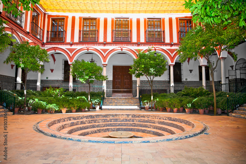 Fototapeta Typical andalusian courtyard with fountain, Seville, Spain.