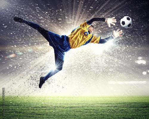Photo sur Toile Le football Goalkeeper catches the ball