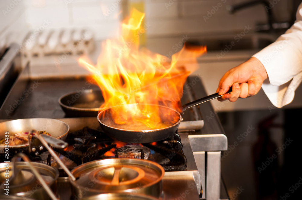 Fototapety, obrazy: Chef cooking in kitchen stove