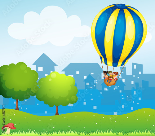 Printed kitchen splashbacks Magic world A big hot air balloon above the hill