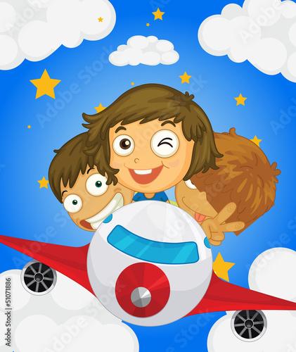 Deurstickers Vliegtuigen, ballon A plane with three kids