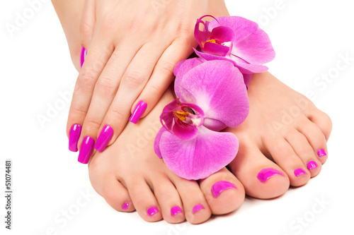 Staande foto Manicure pink manicure and pedicure with a orchid flower. isolated