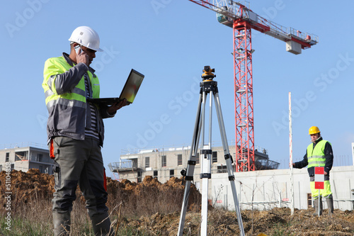 Two surveyors working on site