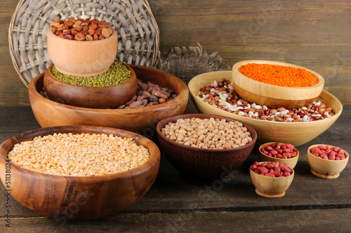 Canvas Prints Herbs 2 Different kinds of beans in bowls on wooden background