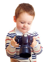 Small Baby Boy Checking The Results Of Photo Shoot