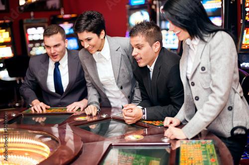 фотография  Excited group in casino