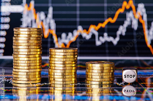 Fotografía  Downtrend financial chart, stacks of golden coins and dices cube