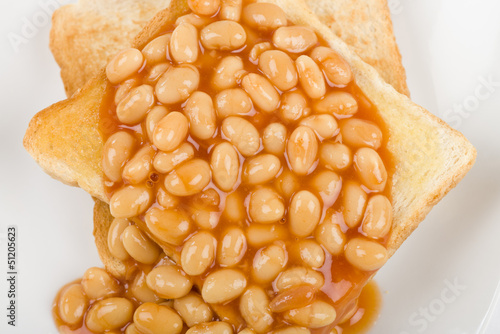 Photo  Beans on Toast - Toasted bread slices topped with baked beans.
