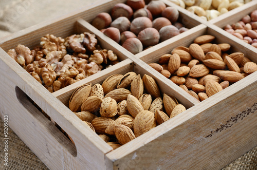 Fotografie, Obraz  Nut mix in wooden box - walnut, almond, hazelnut, cashew and pea