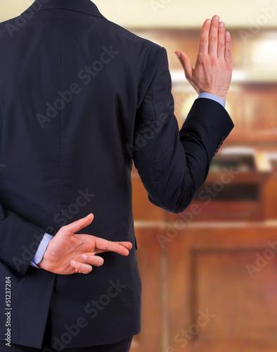 Vászonkép Business man with fingers crossed.