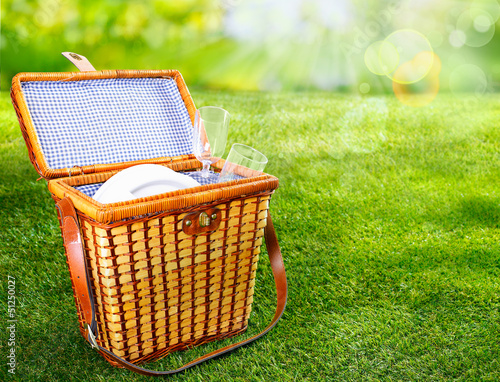 Aluminium Prints Picnic Picnic basket on a sunny green lawn