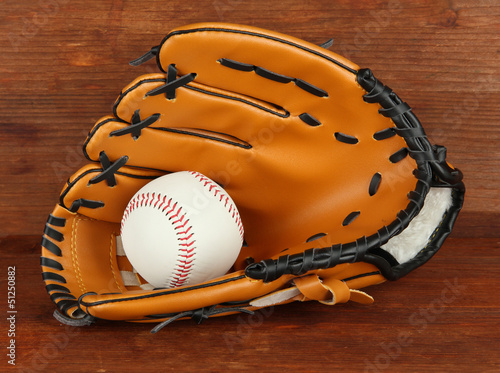 Photo  Baseball glove and ball on wooden background