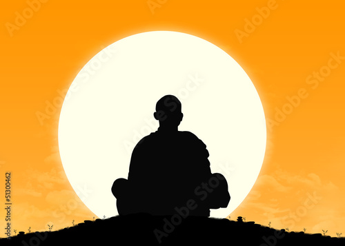 monk in meditation at sunrise Canvas Print