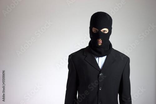 Fotografía  ladro (criminale) in giacca elegante