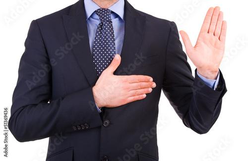 Businessman taking oath. Wallpaper Mural